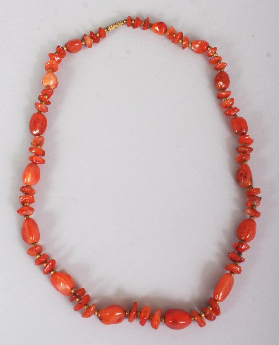 AN AGATE NECKLACE, composed of irregularly formed beads