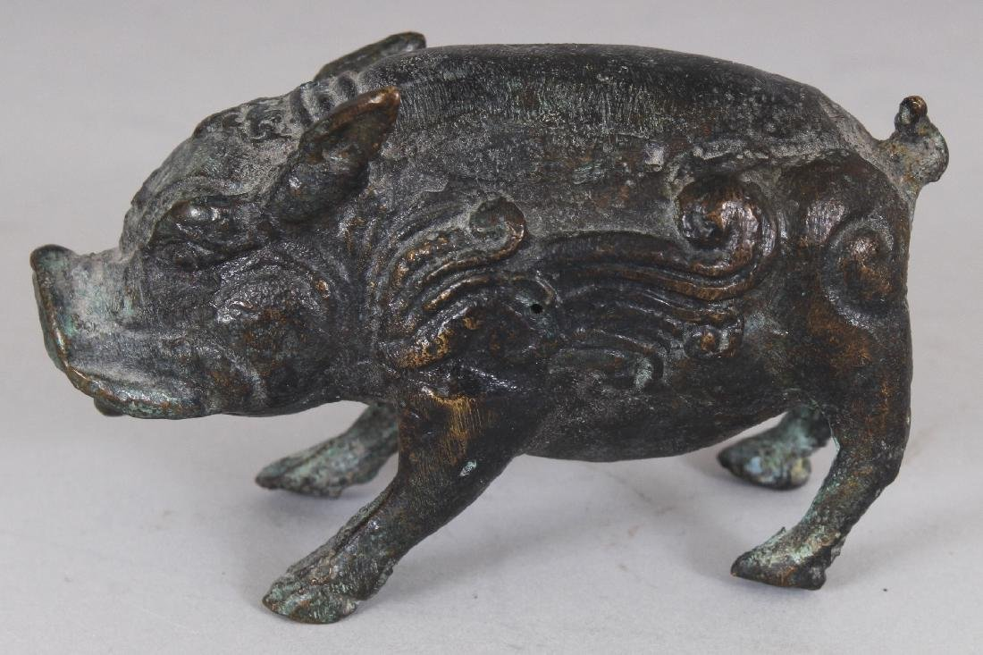 A CHINESE WESTERN ZHAO STYLE BRONZE MODEL OF A BOAR,