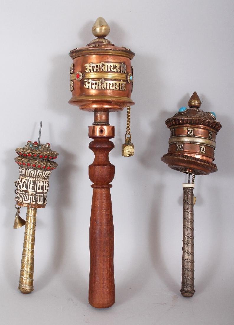 THREE 20TH CENTURY TIBETAN PRAYER WHEELS, the largest