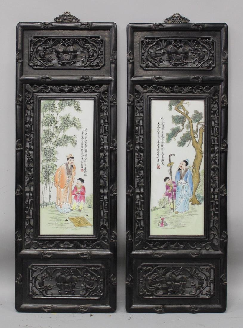 A PAIR OF CHINESE WOOD FRAMED FAMILLE ROSE RECTANGULAR