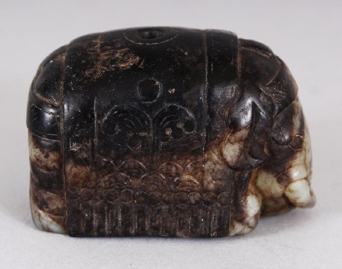 A CHINESE CELADON GREEN & DARK BROWN JADE MODEL OF A