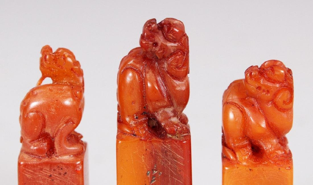 A CHINESE WOOD CASED SET OF THREE SMALL STONE SEALS, - 5