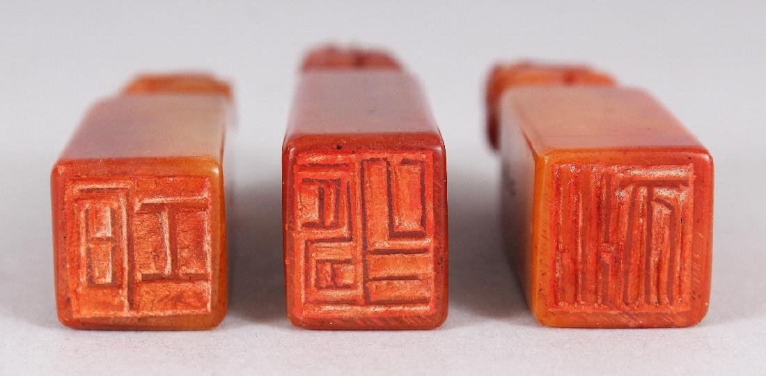 A CHINESE WOOD CASED SET OF THREE SMALL STONE SEALS, - 7