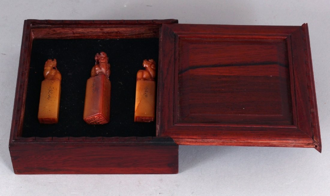 A CHINESE WOOD CASED SET OF THREE SMALL STONE SEALS, - 9