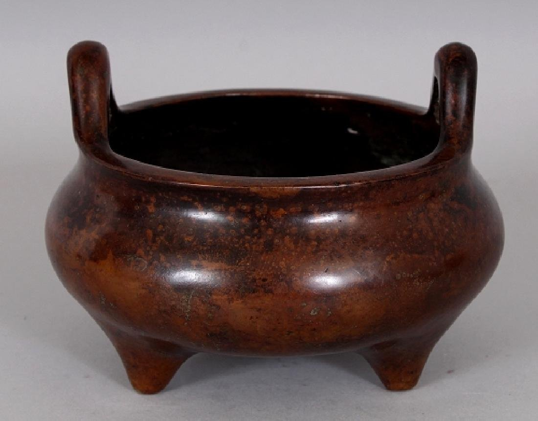 A CHINESE BRONZE TRIPOD CENSER, weighing approx. 865gm,
