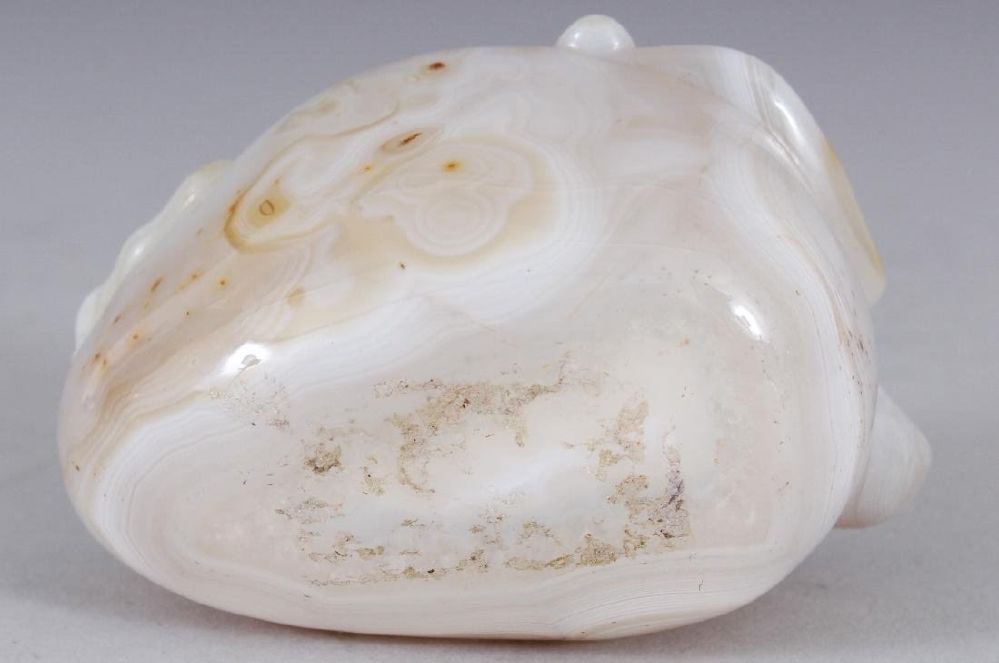 A CHINESE AGATE STYLE LIBATION CUP, 3.5in long & 2in - 5