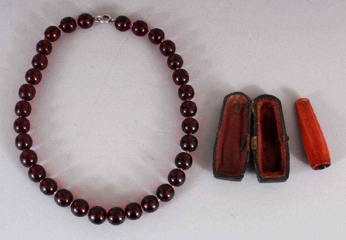 A 'CHERRY AMBER' NECKLACE, weighing approx. 63.1gm,