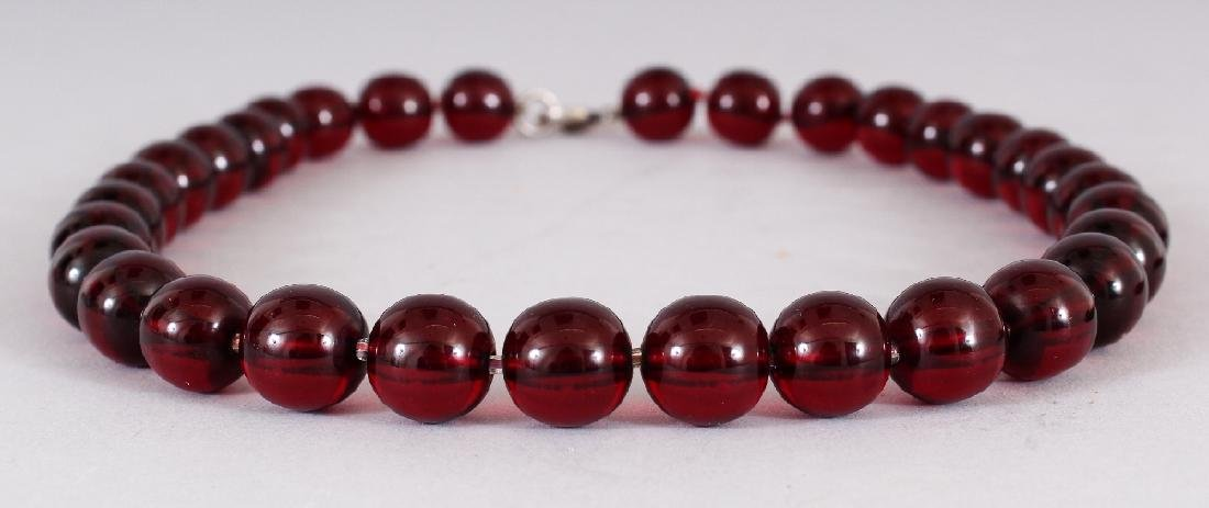 A 'CHERRY AMBER' NECKLACE, weighing approx. 63.1gm, - 2