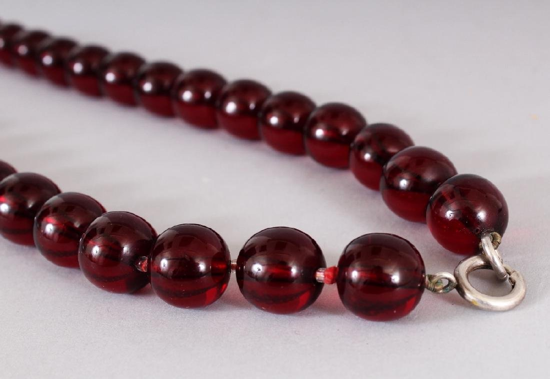 A 'CHERRY AMBER' NECKLACE, weighing approx. 63.1gm, - 3