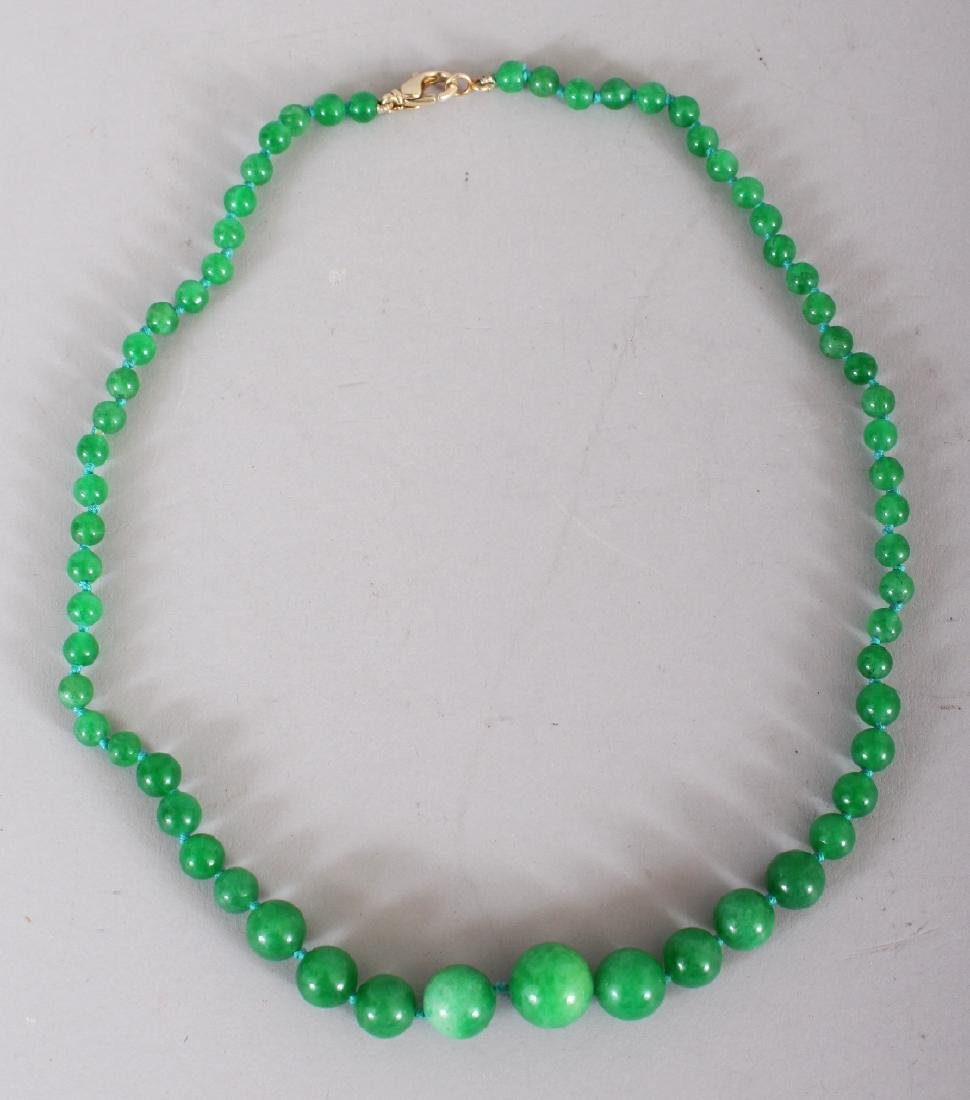 AN APPLE GREEN JADE-LIKE HARDSTONE NECKLACE, composed