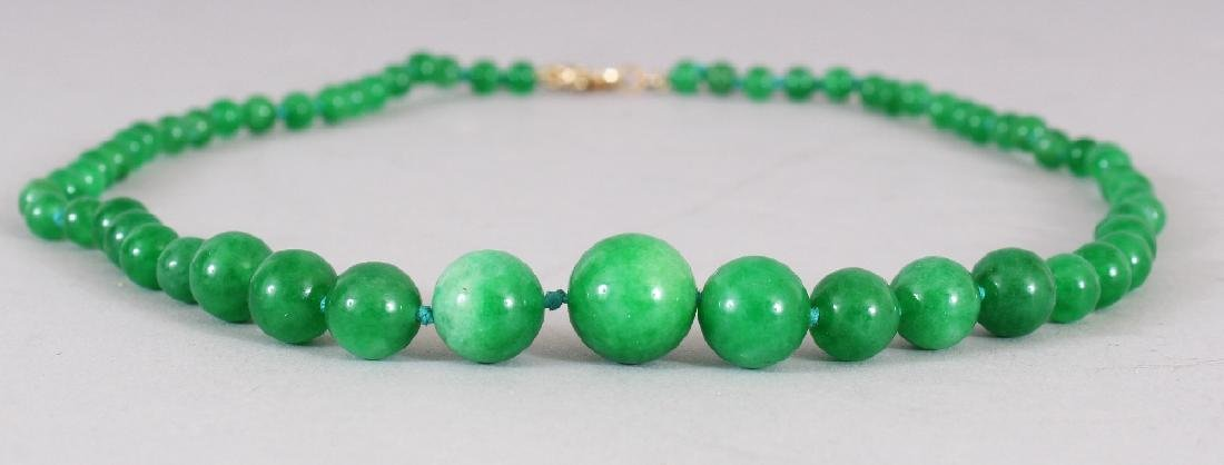 AN APPLE GREEN JADE-LIKE HARDSTONE NECKLACE, composed - 2