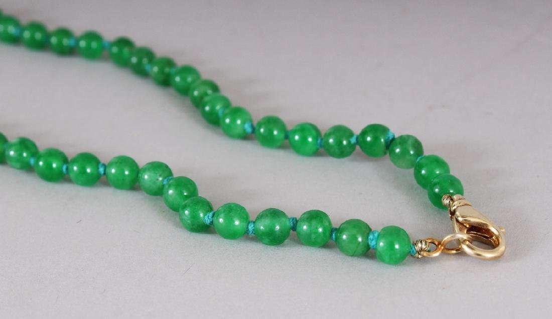 AN APPLE GREEN JADE-LIKE HARDSTONE NECKLACE, composed - 3
