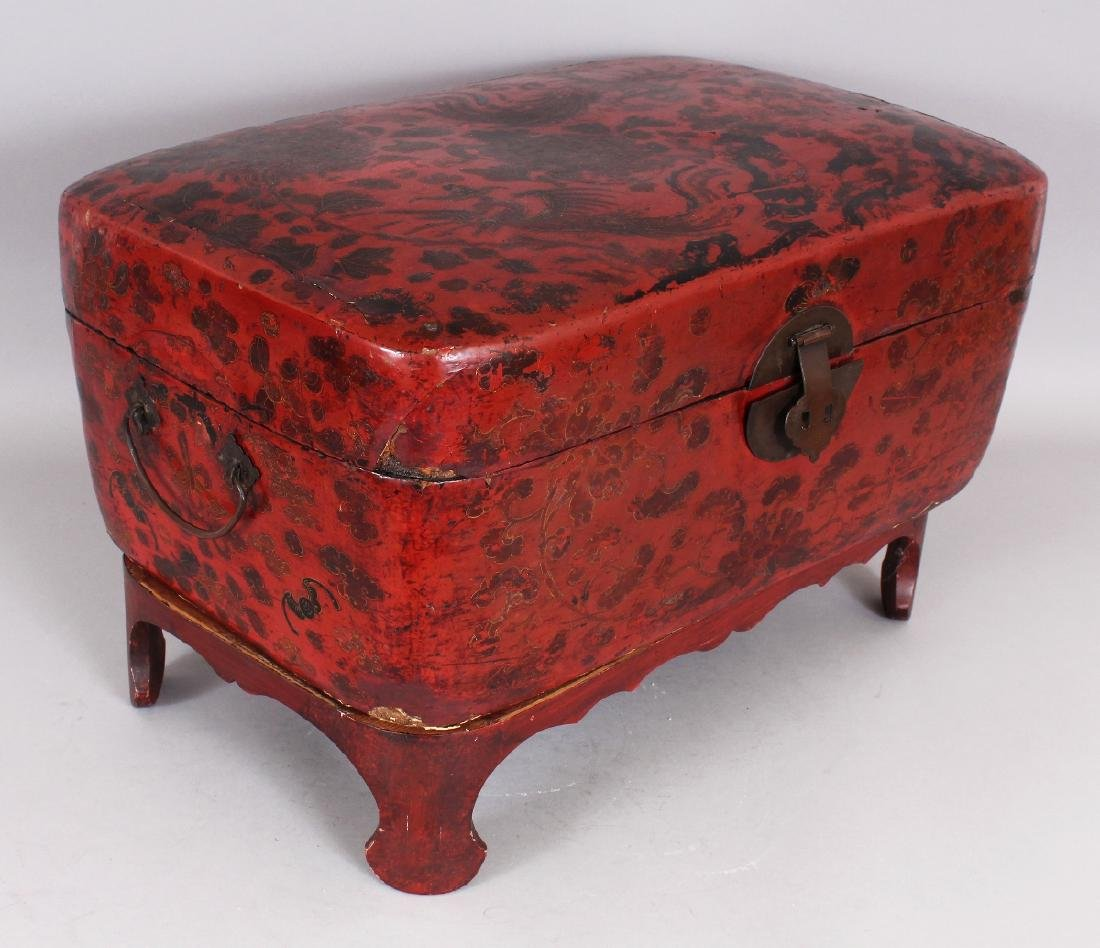 A 19TH CENTURY CHINESE RED GROUND LACQUERED WOOD BOX ON