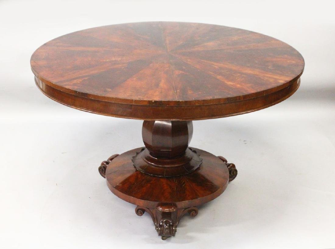 A LATE REGENCY ROSEWOOD CIRCULAR SEGMENTED TOP DINING