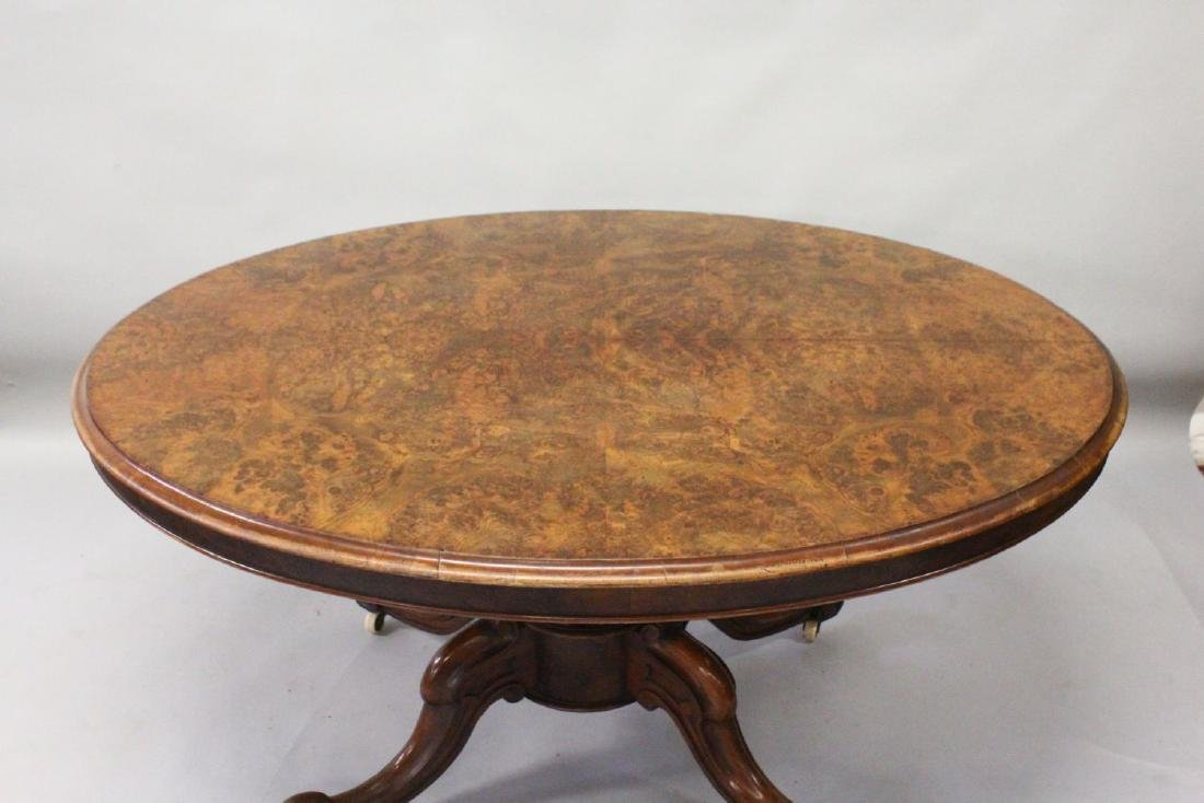 A VICTORIAN FIGURED WALNUT OVAL LOO TABLE, with centre - 2