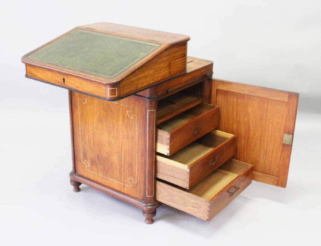 A 19TH CENTURY CAMPHOR WOOD DAVENPORT, with sliding