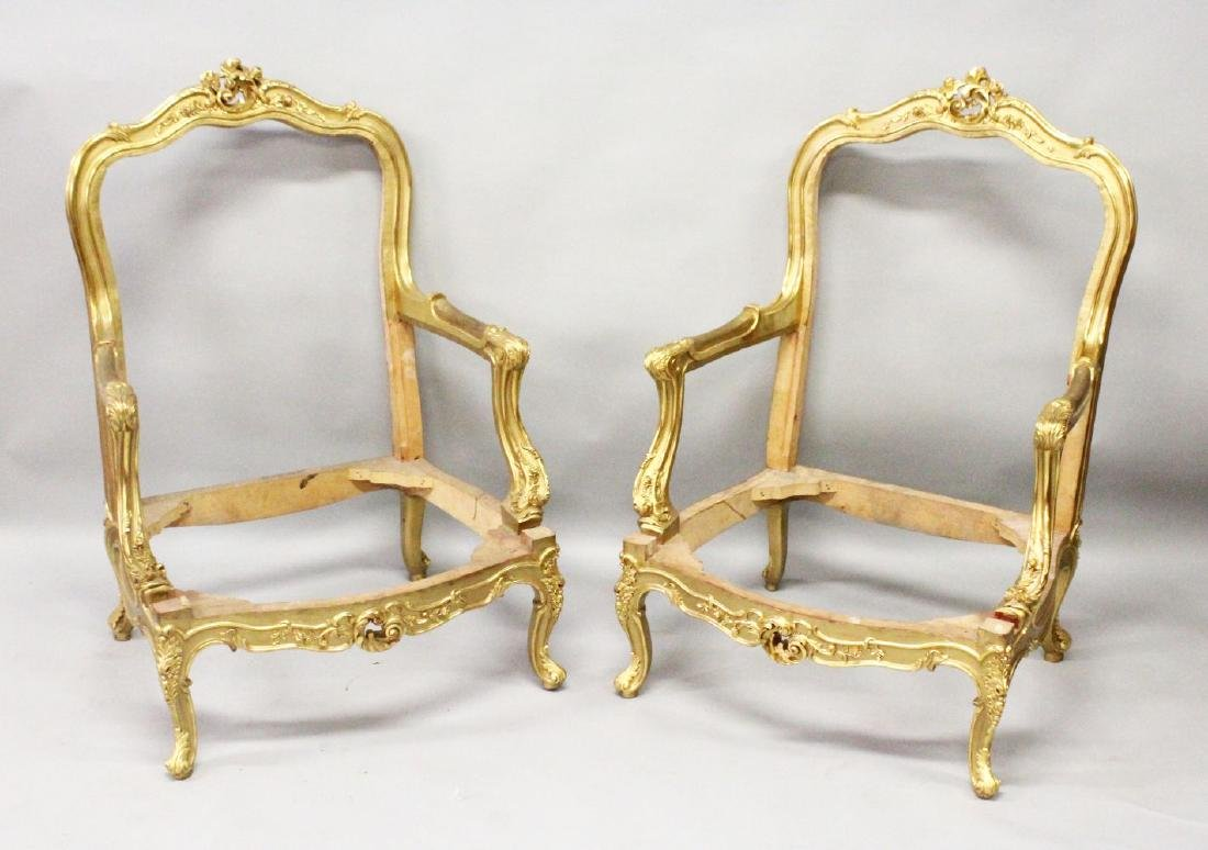 A PAIR OF FRENCH CARVED AND GILDED FAUTEUIL FRAMES.
