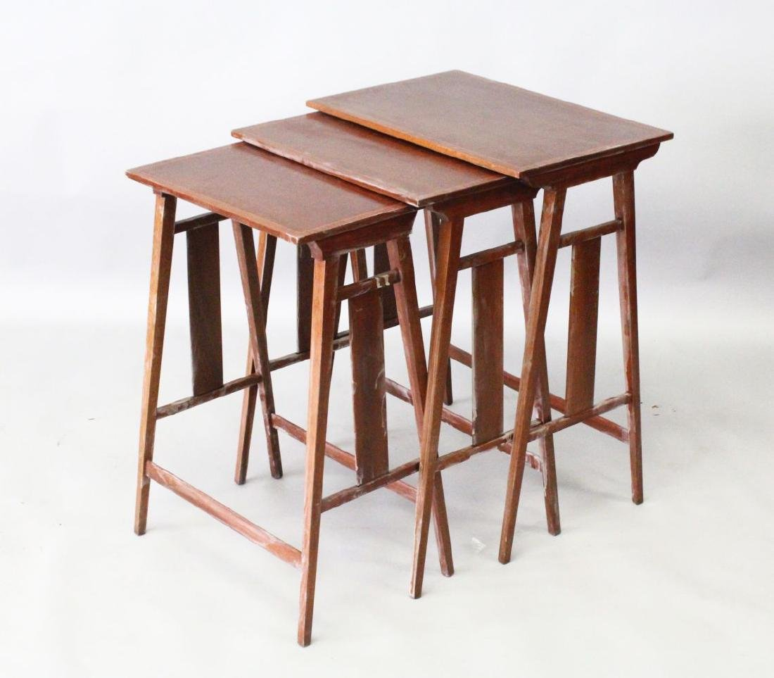 A NEST OF THREE MAHOGANY TABLES, 20TH CENTURY, with