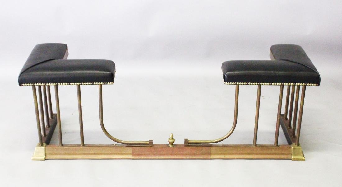 A 20TH CENTURY BRASS AND LEATHER UPHOLSTERED ADJUSTABLE