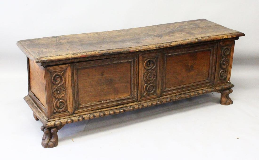 A 17TH CENTURY WALNUT LONG COFFER, with plain top, two