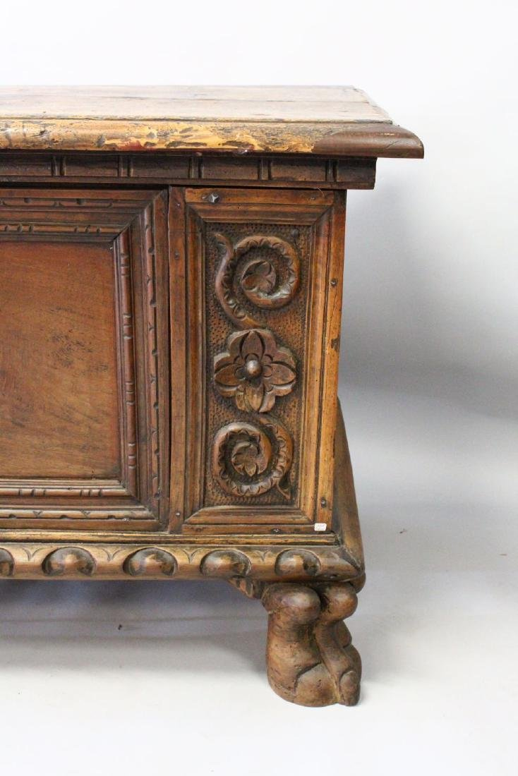 A 17TH CENTURY WALNUT LONG COFFER, with plain top, two - 2