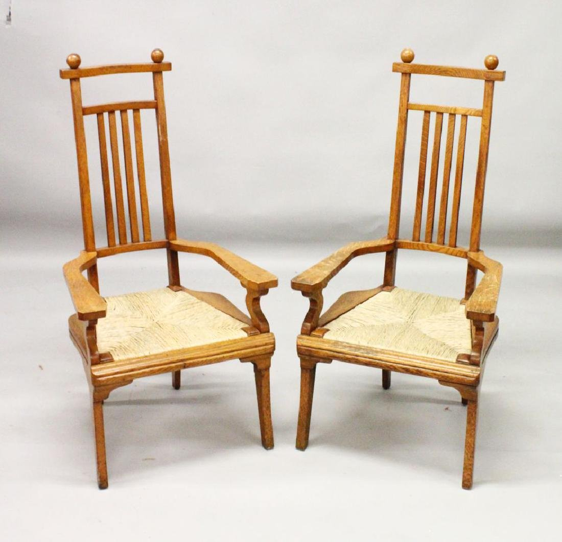 A PAIR OF ARTS & CRAFTS OAK ARMCHAIRS  with spindle