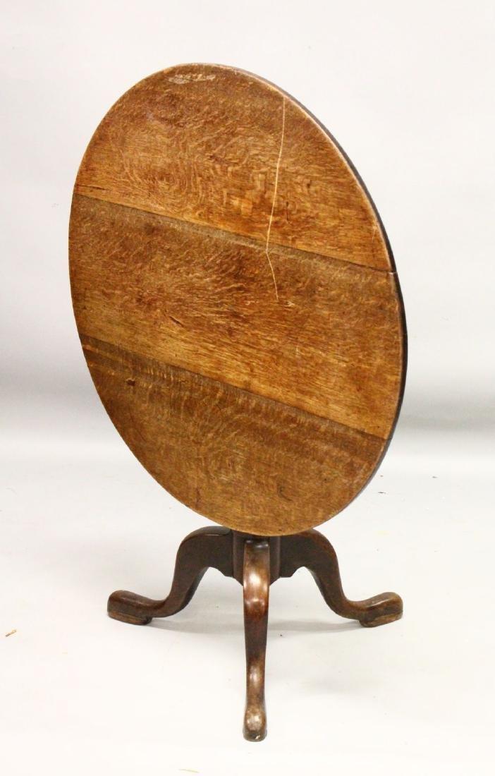 A 19TH CENTURY OAK CIRCULAR TILT TOP TRIPOD TABLE.  2ft