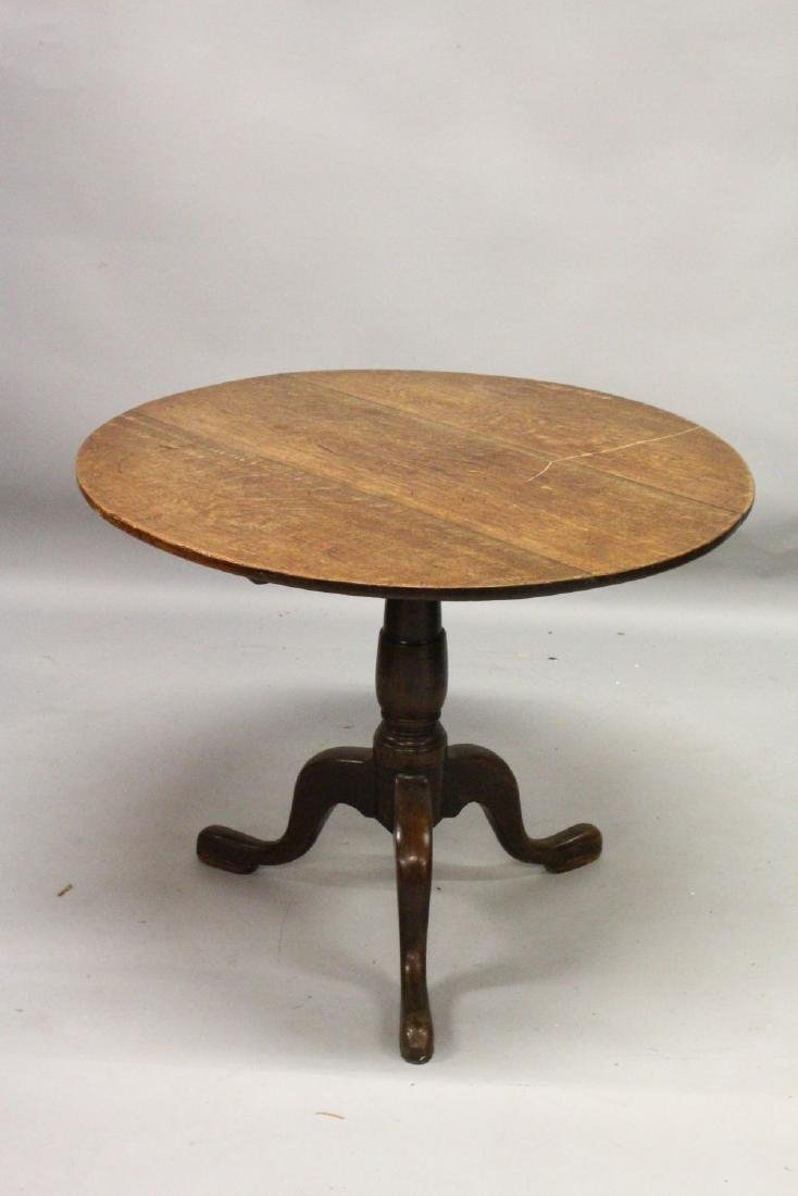 A 19TH CENTURY OAK CIRCULAR TILT TOP TRIPOD TABLE.  2ft - 2