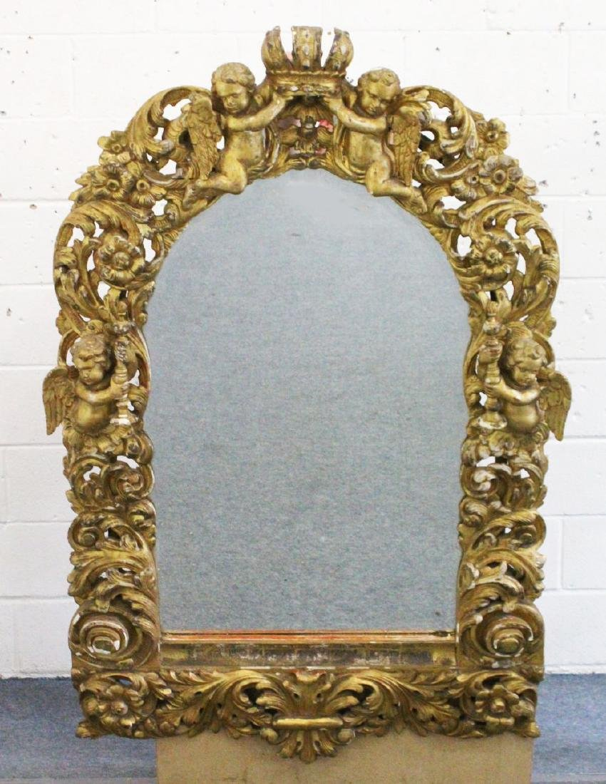 A GOOD 18TH CENTURY ITALIAN CARVED AND GILDED MIRROR,