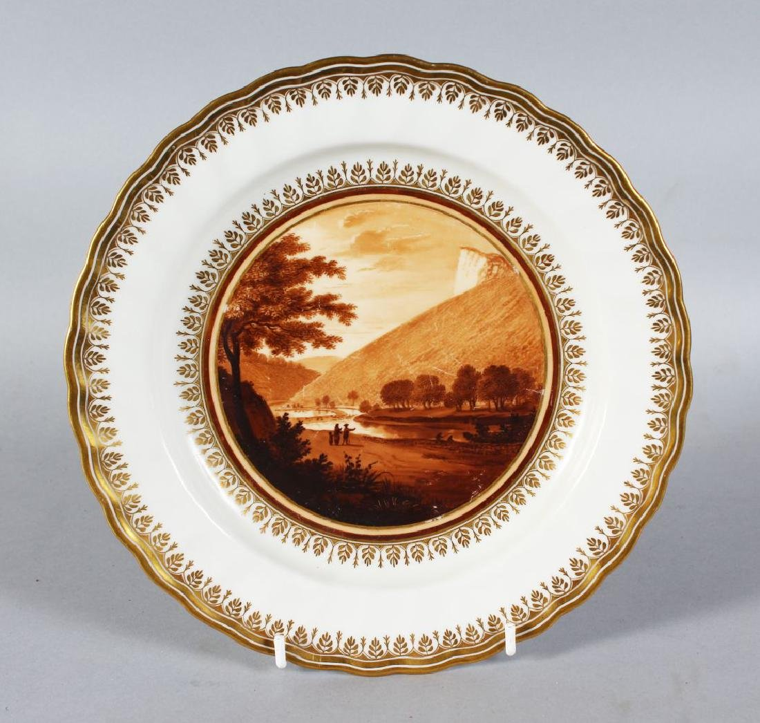 A DERBY PORCELAIN PLATE with waved gilt border, the