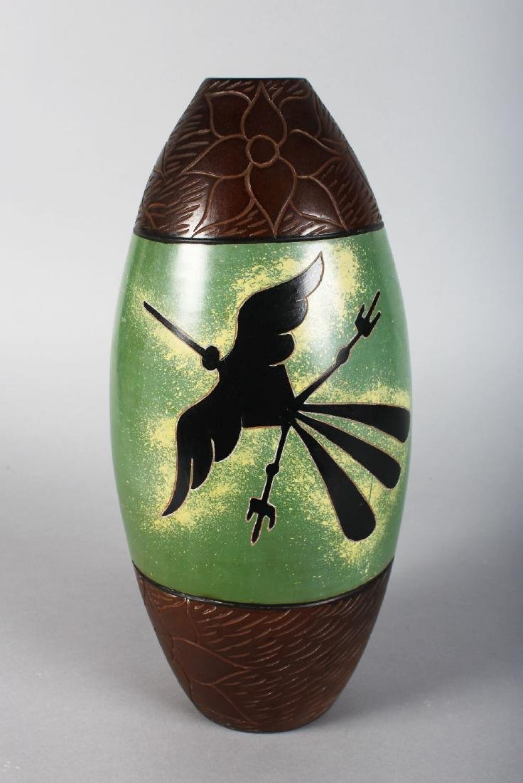 ROSA CARMEN (PERU)  A POTTERY VASE with unusual bird on