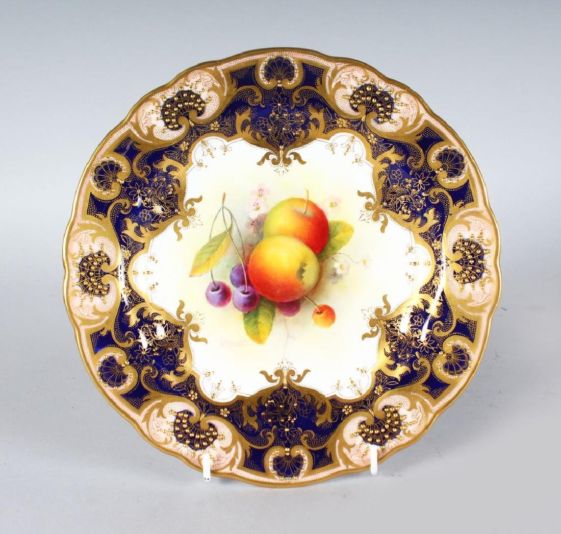 A ROYAL WORCESTER PLATE painted fruit under a heavily