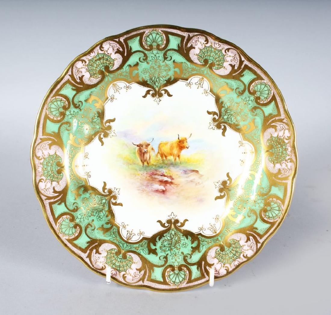 A ROYAL WORCESTER PLATE painted cattle under a heavily