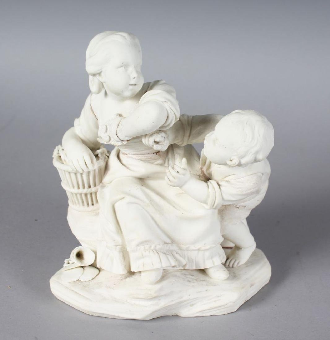 AN 18TH CENTURY SEVRES BISCUIT PORCELAIN FIGURE GROUP