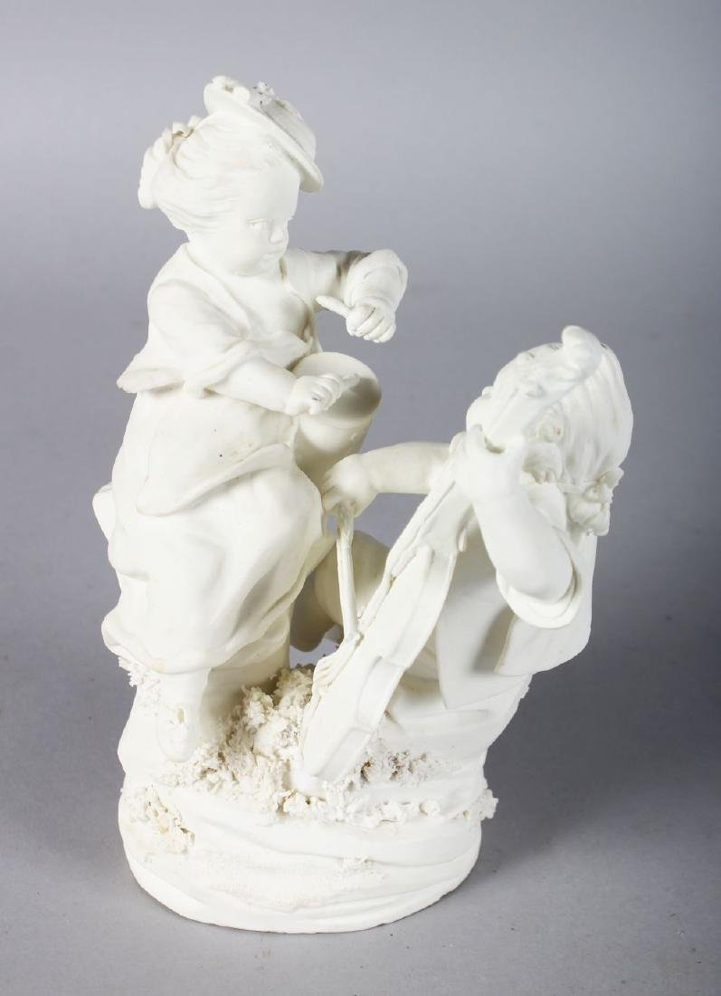 AN 18TH CENTURY MENNECY BISCUIT PORCELAIN FIGURE GROUP