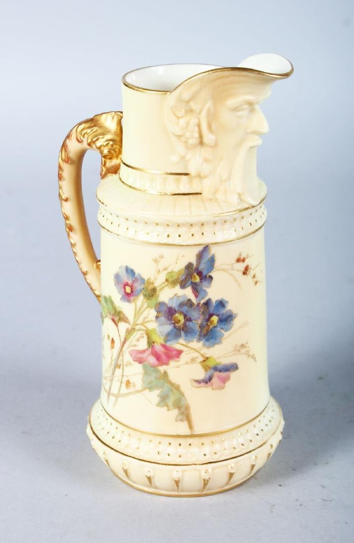 A ROYAL WORCESTER JUG with bearded mask spout painted