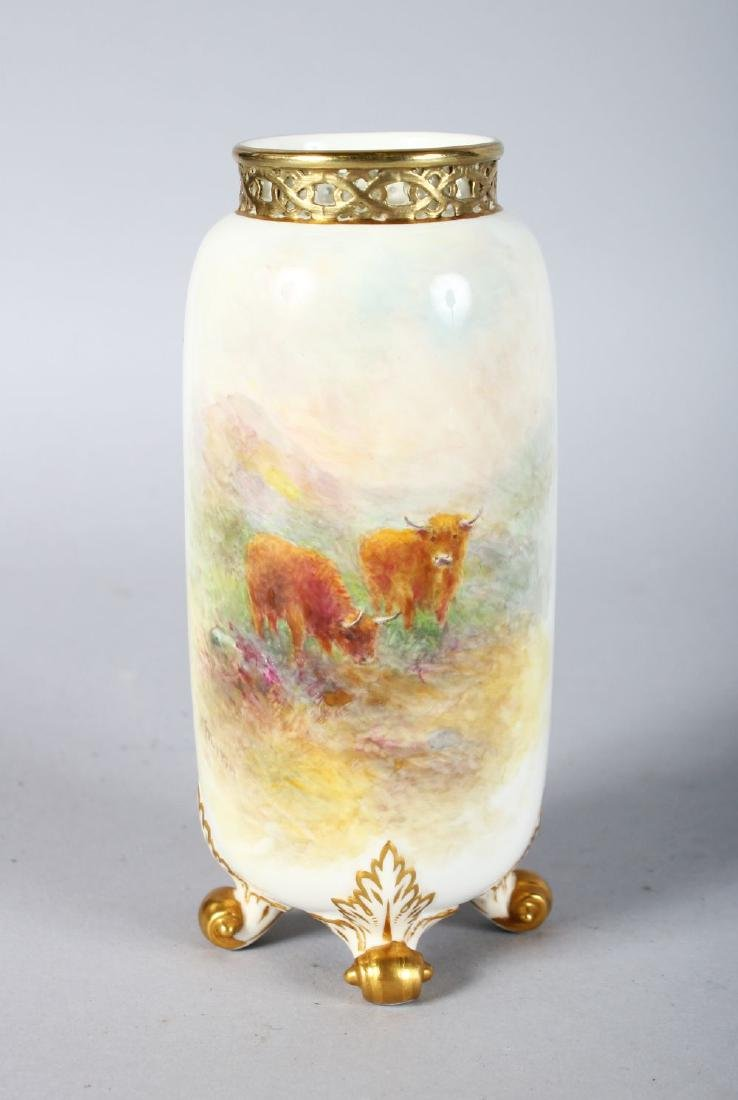 A ROYAL WORCESTER VASE, shape G42, with four feet and a