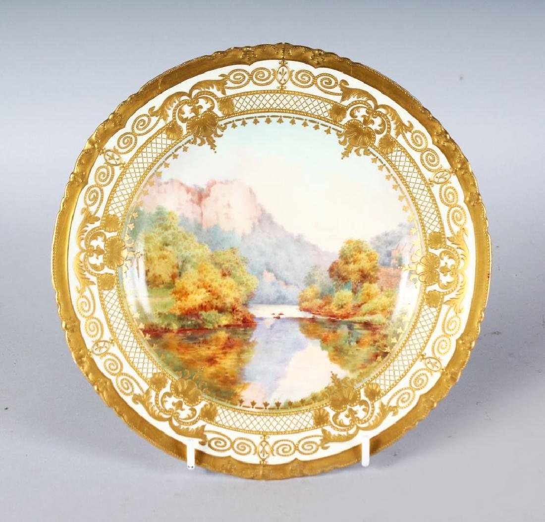 A ROYAL CROWN DERBY FINE PLATE painted and titled with