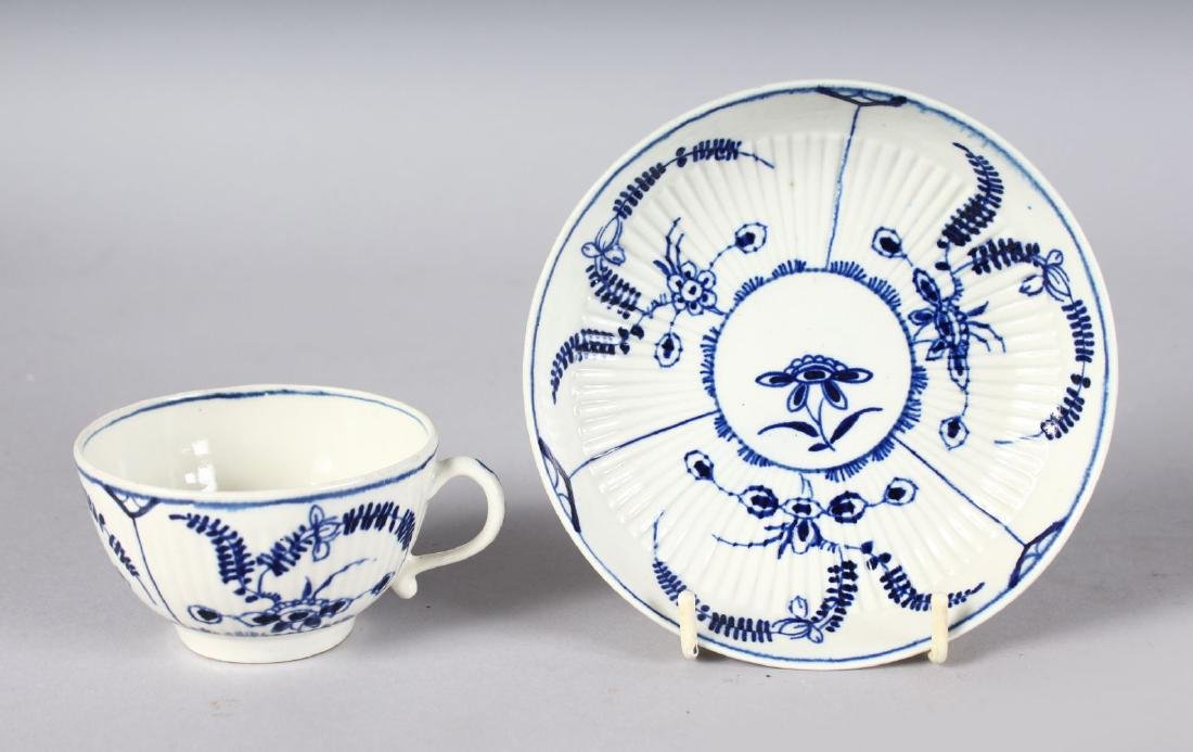 AN 18TH CENTURY WORCESTER TEACUP AND SAUCER painted in