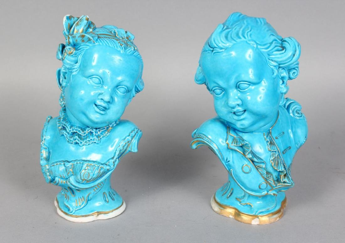 TWO GOOD NEAR MATCHING SEVRES BLUE BUSTS OF YOUNG BOYS,