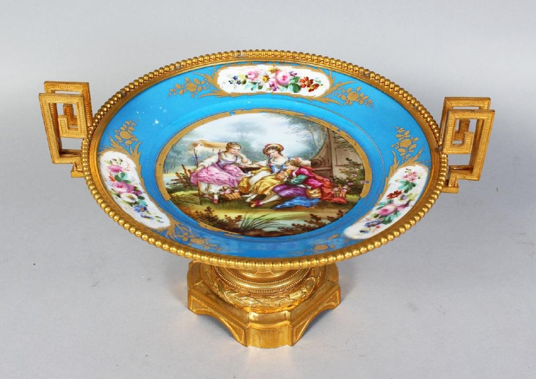 A GOOD SEVRES PORCELAIN CIRCULAR COMPORT, painted with
