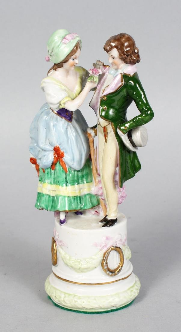 A CAPODIMONTE GROUP OF A YOUNG MAN AND YOUNG GIRL, on a