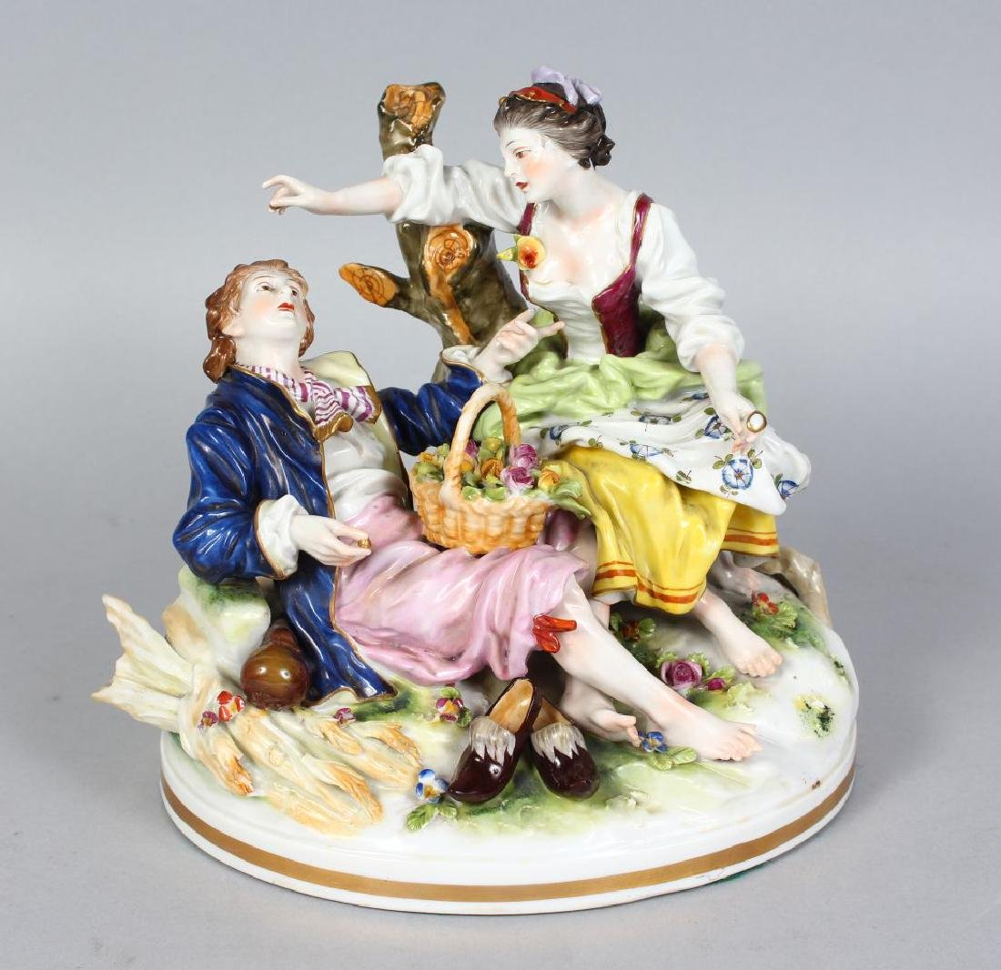 A CAPODIMONTE PORCELAIN GROUP OF A YOUNG MAN AND GIRL