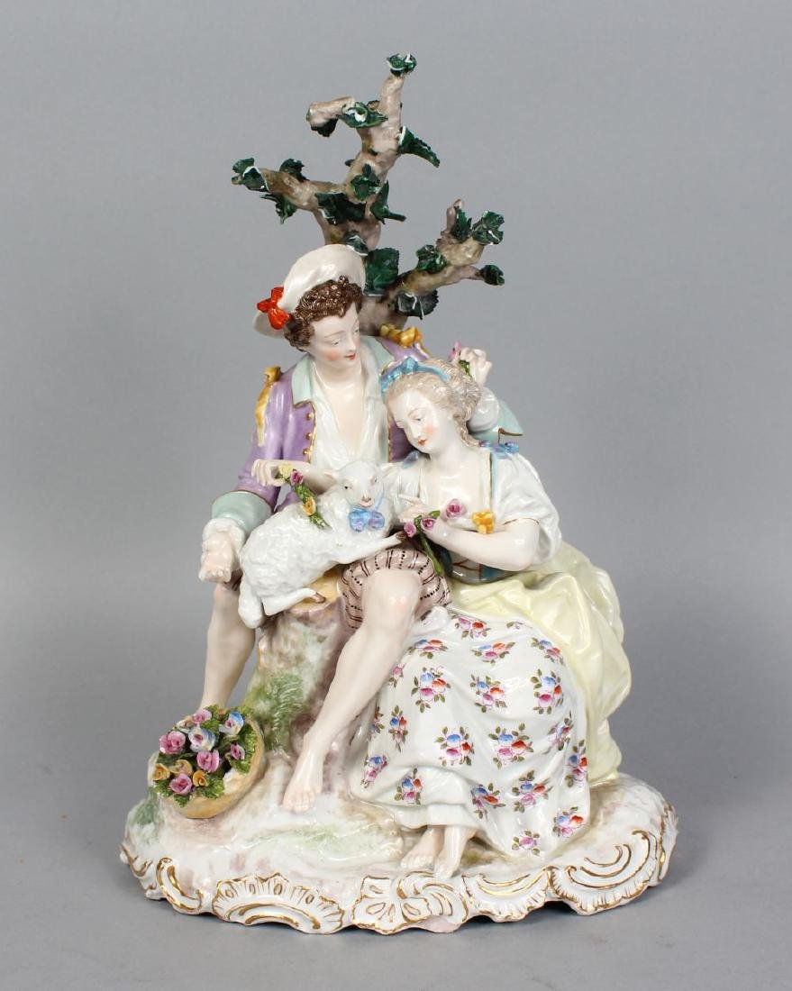 A GOOD MEISSEN GROUP OF A YOUNG MAN AND WOMAN, a lamb