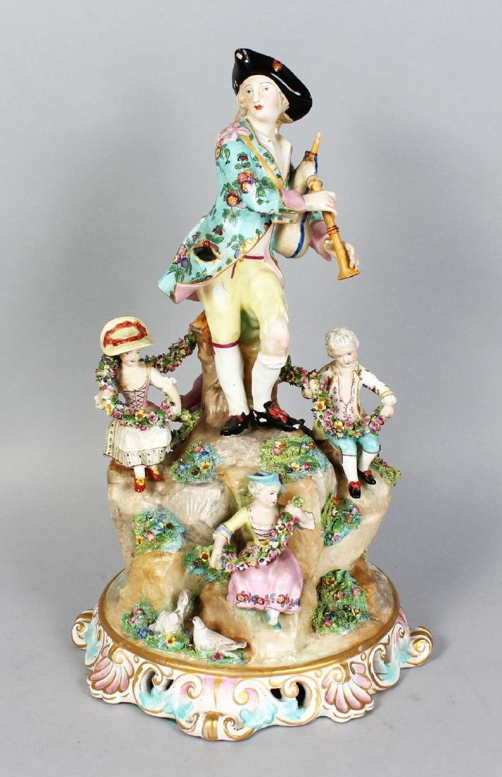 A LARGE MEISSEN STYLE MODEL OF A GROUP OF A MUSICIAN