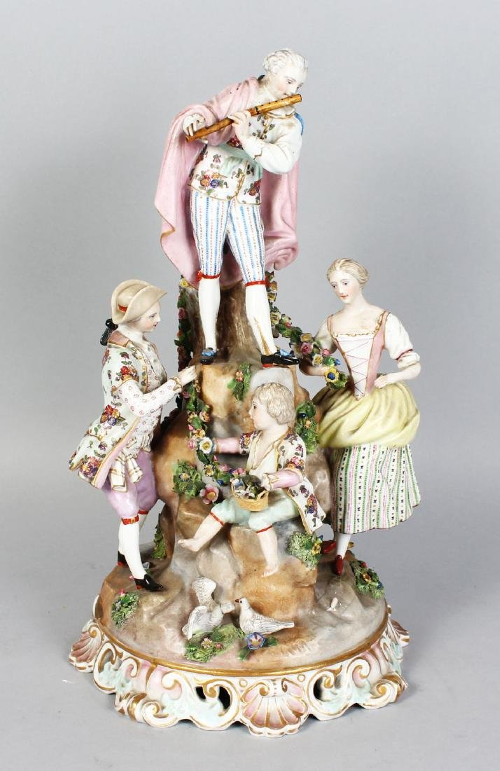 "A LARGE ""MEISSEN"" MODEL OF A MAN playing a flute, and"
