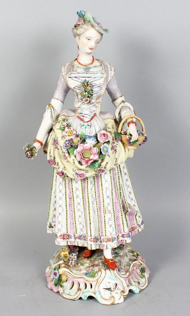 "A LARGE ""MEISSEN"" MODEL OF A YOUNG LADY, carrying a"