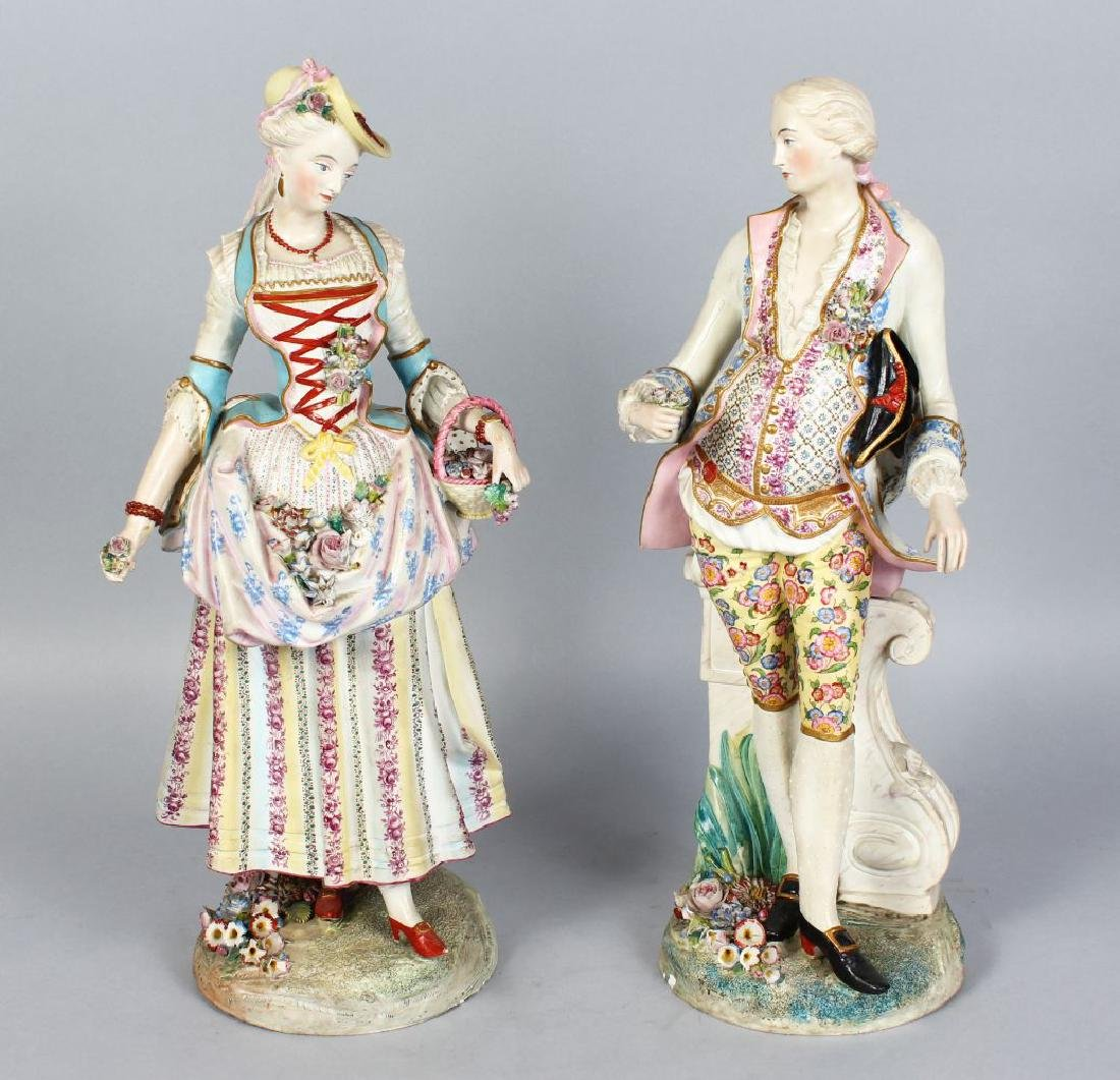 A PAIR OF CONTINENTAL PAINTED PORCELAIN FIGURES OF A