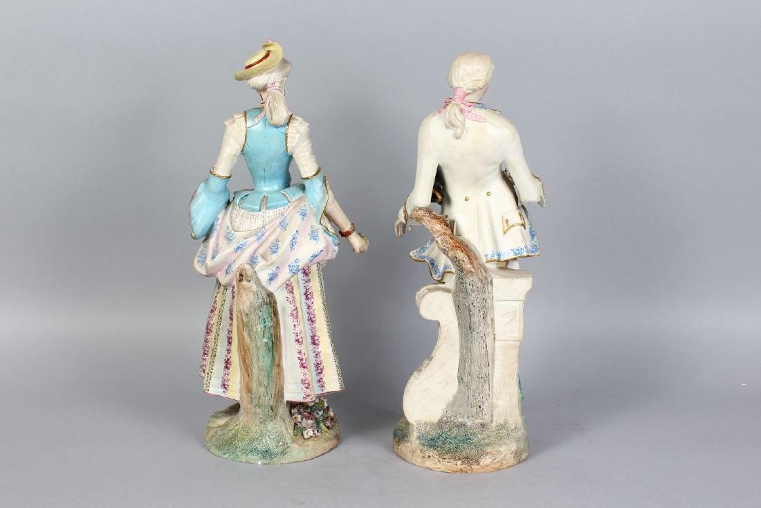 A PAIR OF CONTINENTAL PAINTED PORCELAIN FIGURES OF A - 2