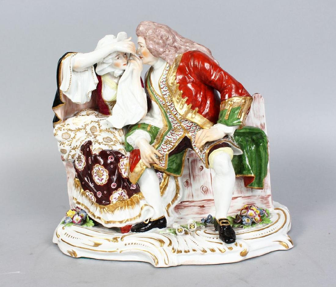 A CONTINENTAL PORCELAIN GROUP, A MAN AND YOUNG LADY